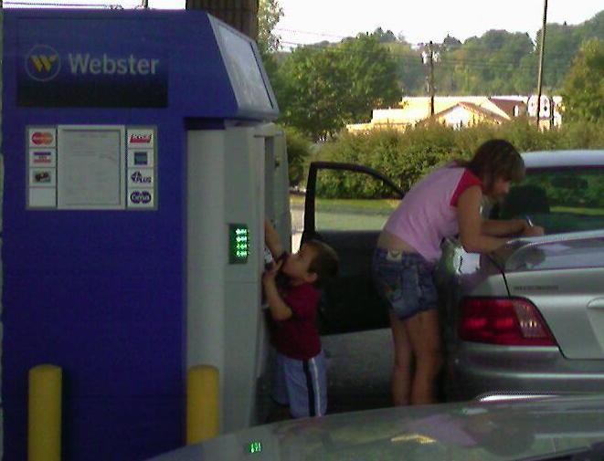 Woman at Drive-Up Bank ATM Machine - Funny